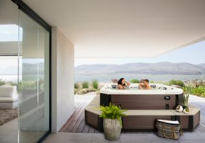 View of lake from patio of modern house --- Image by © Martin Barraud/OJO Images/Corbis